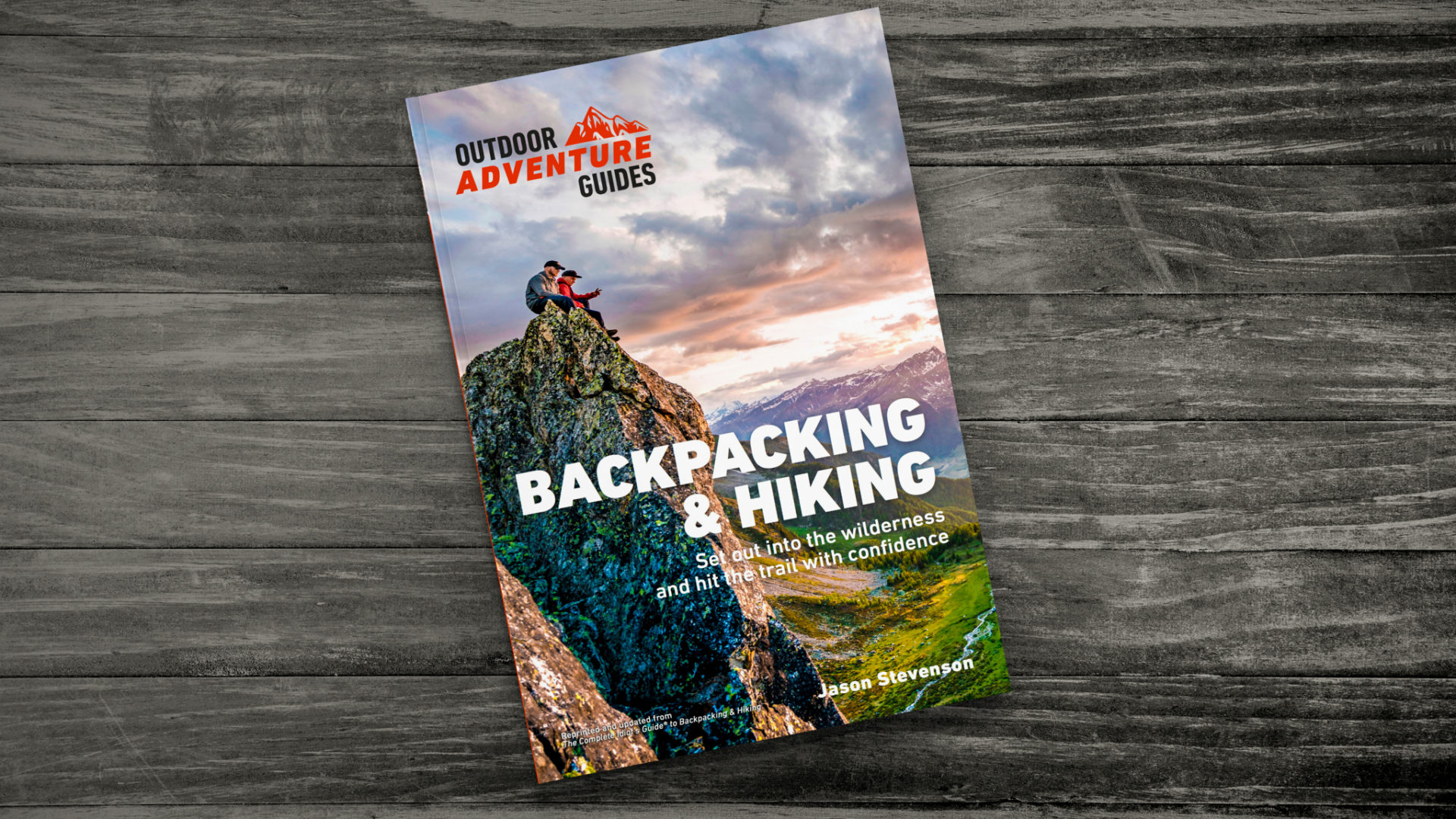 Backpacking & Hiking Outdoor Adventure Guides on dark grey wood