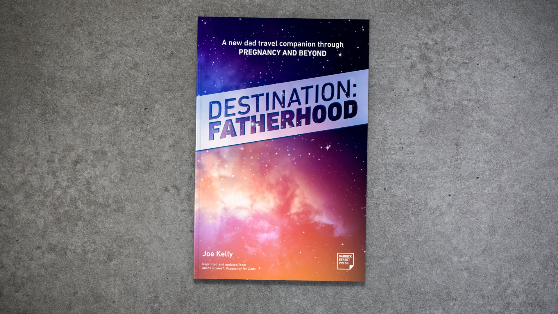 Destination Fatherhood on grey weathered tabletop.