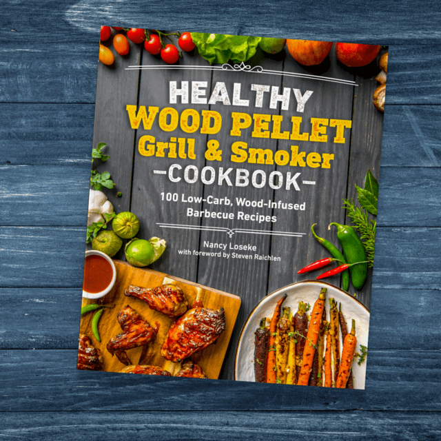 Healthy Wood Pellet Grill & Smoker Cookbook on distressed blue tabletop.